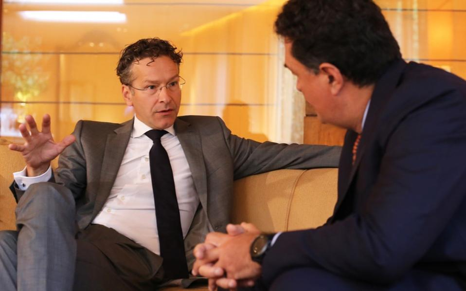 'Let's make absolutely sure that together we complete the program, we manage the exit from the program well and have a deal on debt,' Jeroen Dijsselbloem tells Kathimerini's Alexis Papachelas.