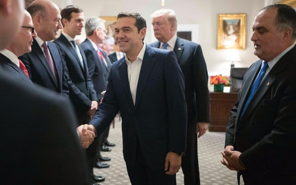 Deputy chief of protocol at the State Department Michael Karloutsos (at right), was at Prime Minister Alexis Tsipras's side throughout his Washington visit.
