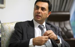 Turkish Cypriot chief negotiator in reunification talks Ozdil Nami speaks during an interview with Reuters.