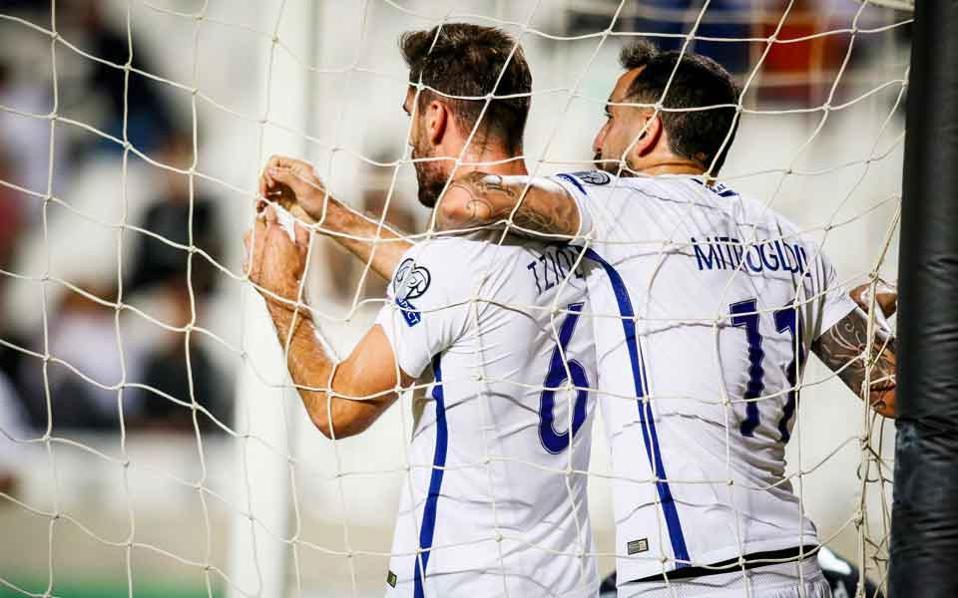 Greece's scorers Alexandros Tziolis and Costas Mitroglou