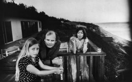 Joan Didion with her husband and daughter in their home in Malibu, California. [John Bryson]