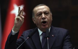 Turkey's President Recep Tayyip Erdogan addresses his supporters at the parliament in Ankara, Tuesday.