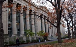 Students walk past Harvard Law School. Greece has a proportionately high number of academics at top US universities.