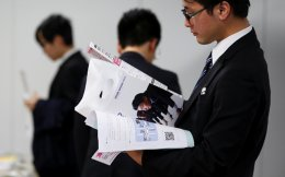 Job seekers attend a job fair held for fresh graduates by ACCESS Humanext Co, in Tokyo, Japan, on Friday.