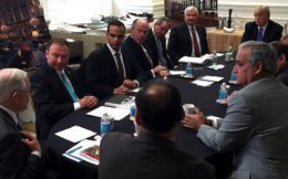 George Papadopoulos (third from left) sits at a table with then-US presidential candidate Donald Trump and others during a meeting in Washington in this photo that was posted on Trump's Twitter account on March 31.