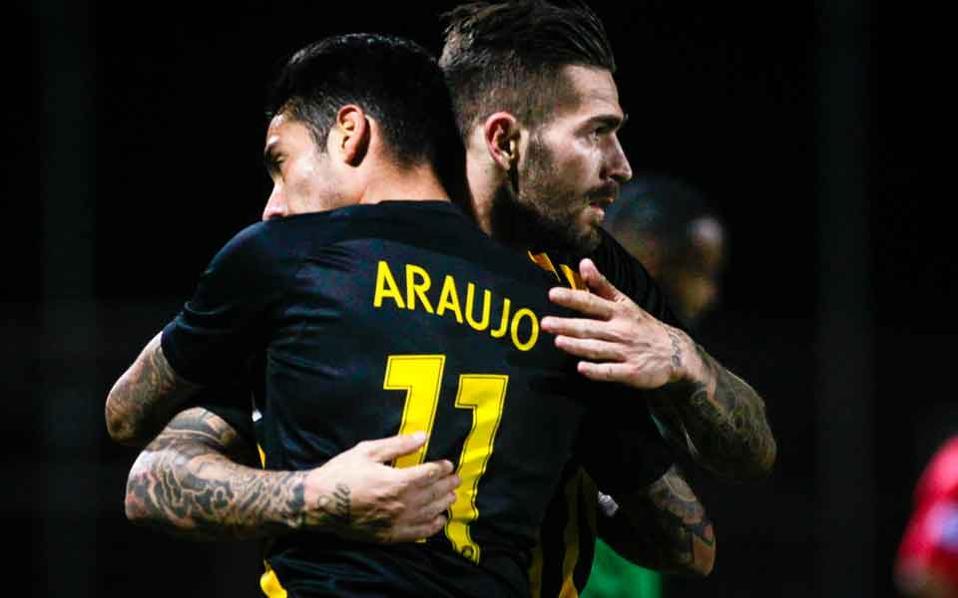 AEK goalscorers Livaja and Araujo enjoy the win at Livadia.
