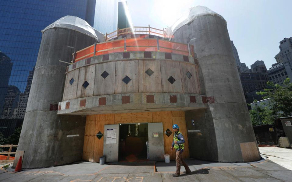 In this Aug. 10, 2017 file photo, a construction worker walks in front of the St. Nicholas National Shrine in New York. Work on the Greek Orthodox church destroyed in the Sept. 11 attacks next to the World Trade Center memorial plaza has been temporarily suspended by the construction company.