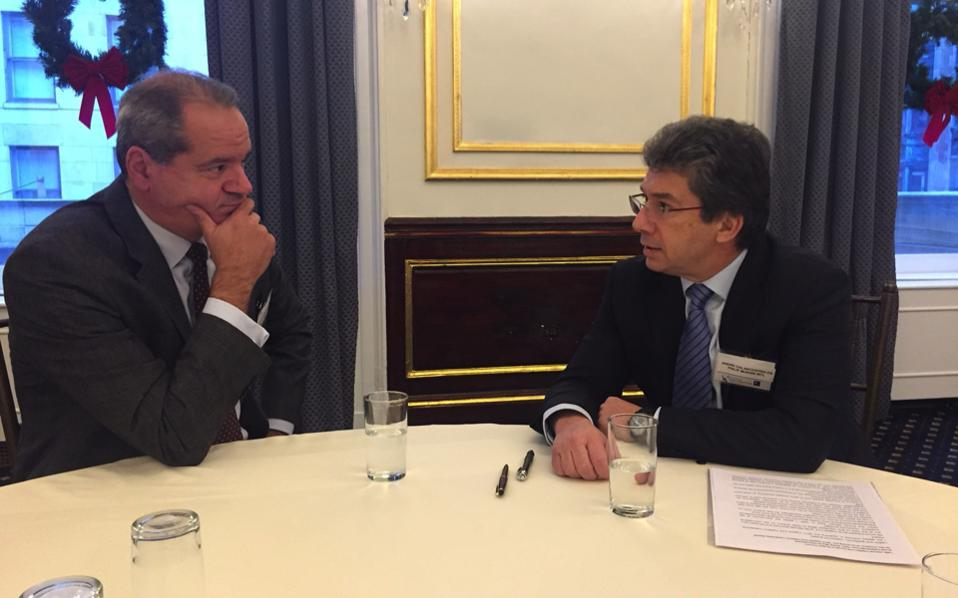 Philip Morris International CEO Andre Calantzopoulos (right), seen during an interview with Kathimerini English Edition editor in chief Tom Ellis at the Metropolitan Club of New York on the sidelines of the Capital Link Invest in Greece Forum earlier in December.