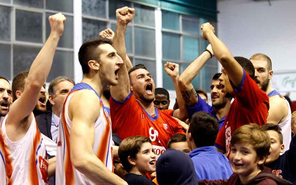 Panionios players celebrated their first win this season.