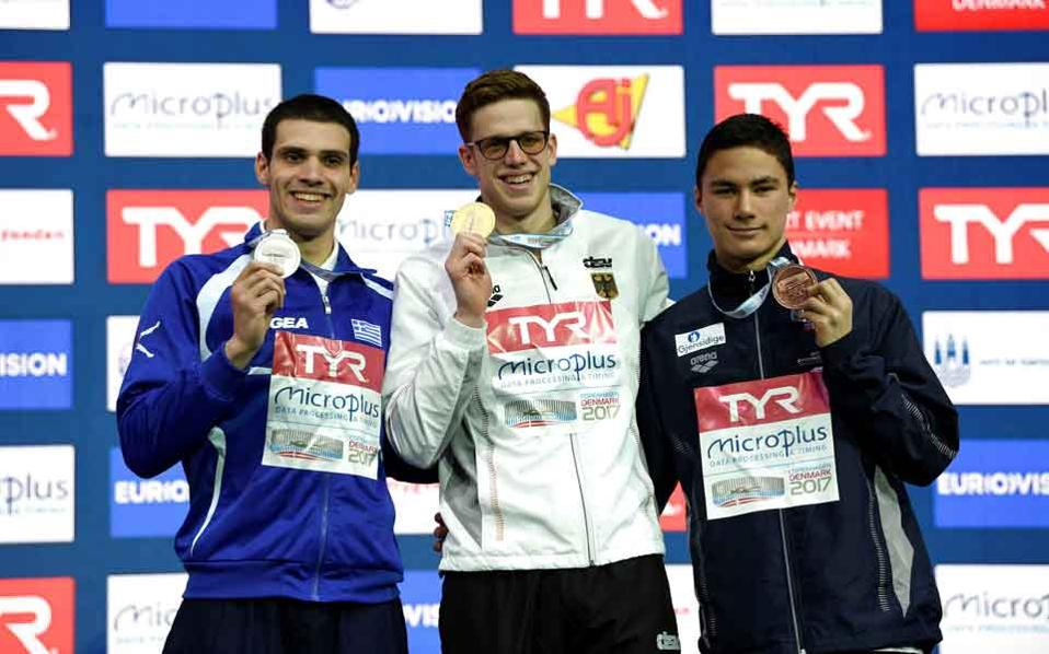 Vazaios, left, won his first silver at the European Short Course Championships.