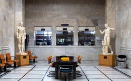 Copies of celebrated ancient statues keep an eye on things at City Hall's Birth Registry Office.