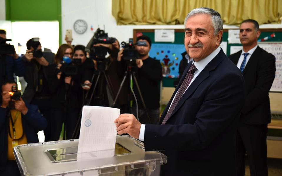 Turkish-Cypriot leader Mustafa Akinci casts his ballot during Sunday's election in Turkish-occupied Cyprus.