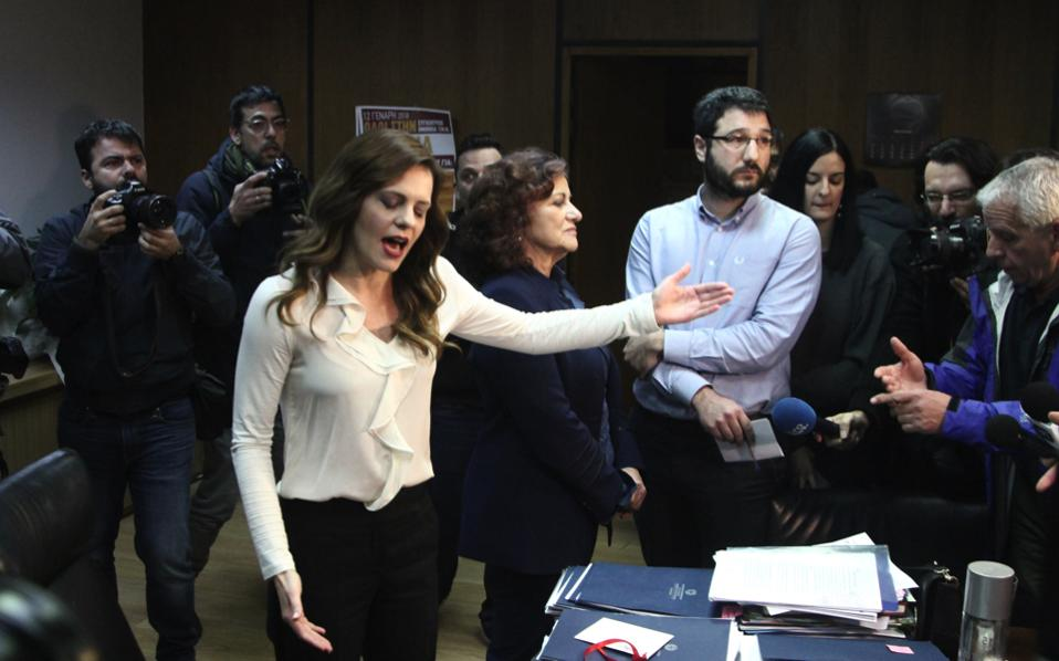 Greek Labor Minister Efi Achtsioglou gestures during an invasion of her office by supporters of Greece's Communist Party (KKE) protesting planned new bailout-linked reforms in Athens, on Tuesday.