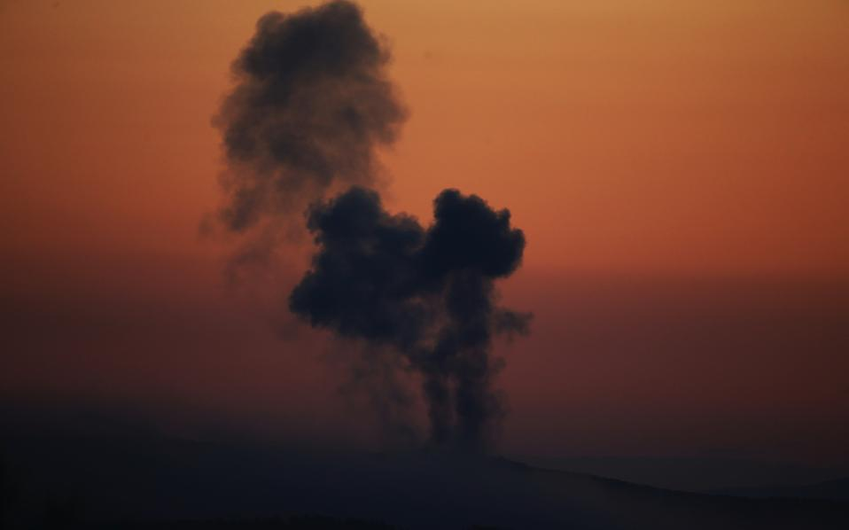 In this Saturday, Jan. 20 file photo, plumes of smoke rise on the air from inside Syria, as seen from the outskirts of the border town of Kilis, Turkey.