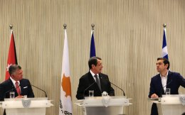 Cyprus's President Nicos Anastasiades (c) talks to the media as Jordan's King Abdullah II (l) and Greek Prime Minister Alexis Tsipras listen during a press conference at the Presidential palace in capital Nicosia, on Tuesday.