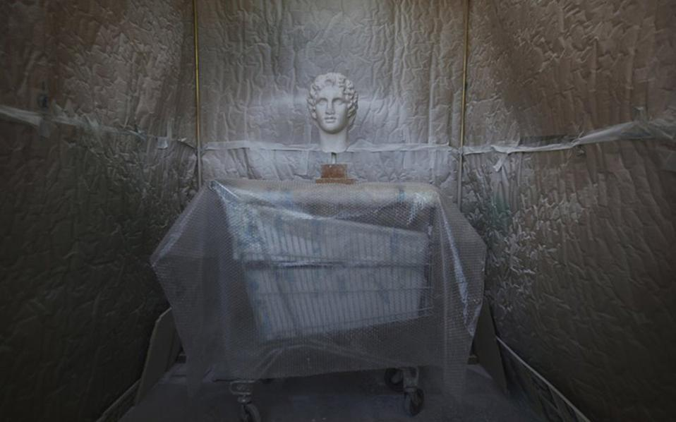 A copy of the head of Alexander the Great goes through color processing. [Thanassis Stavrakis/AP]