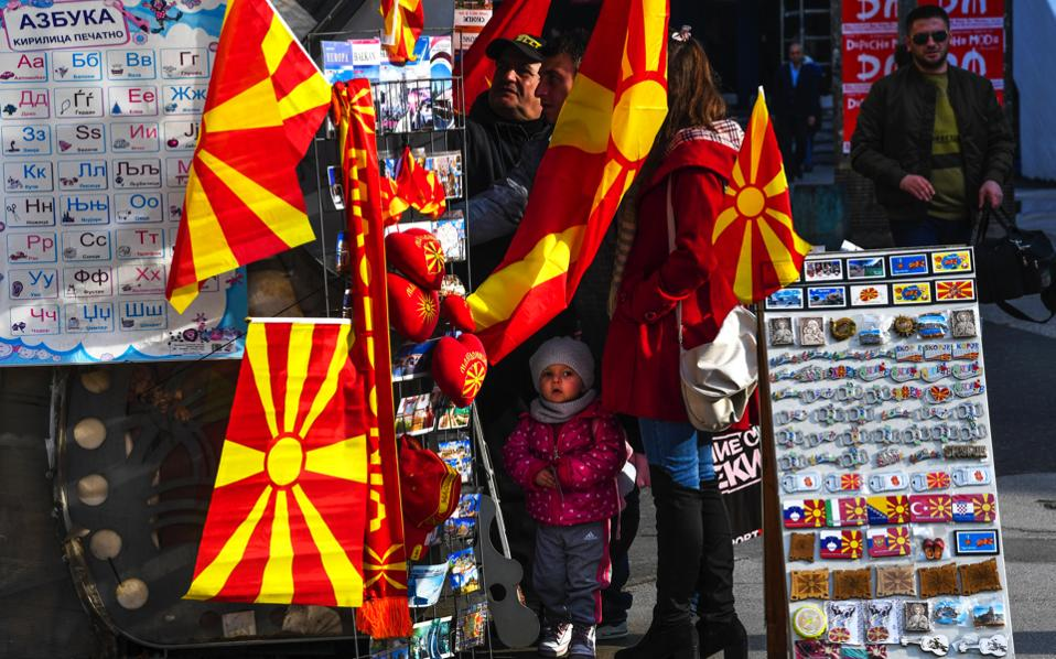People look for souvenirs at a stall at the main square of Skopje on Tuesday.