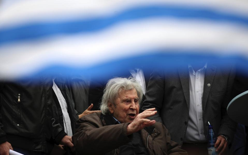 Veteran Greek composer Mikis Theodorakis waves to the crowd after his speech at Sunday's 'Macedonia' rally in Athens.
