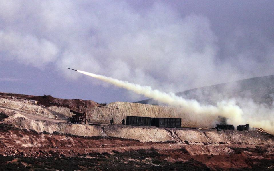 Turkish artillery fires toward Syrian Kurdish positions in Afrin area, Syria, from Turkish side of the border in Hatay, Turkey, Friday.