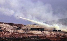 Turkish artillery fires toward Syrian Kurdish positions in Afrin area, Syria, from Turkish side of the border in Hatay, Turkey, Friday.