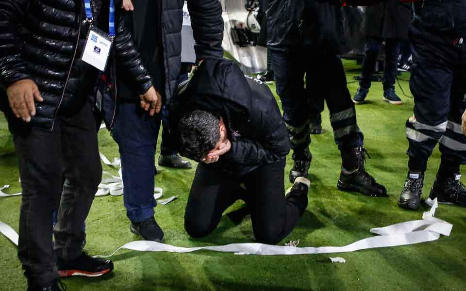 Greek football match stopped after team owner invades pitch with a gun