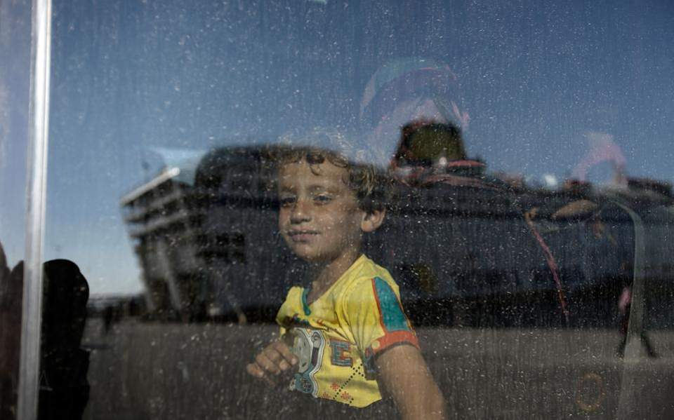refugee_kid_bus_web-thumb-large-thumb-large