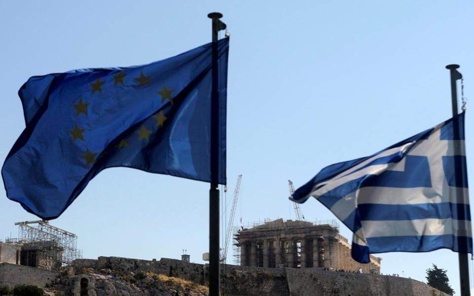 Greece 'turns a page' as it reaches deal on bail-out exit