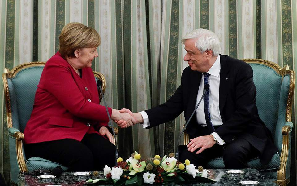 Merkel says Germany conscious of responsibility for Nazism