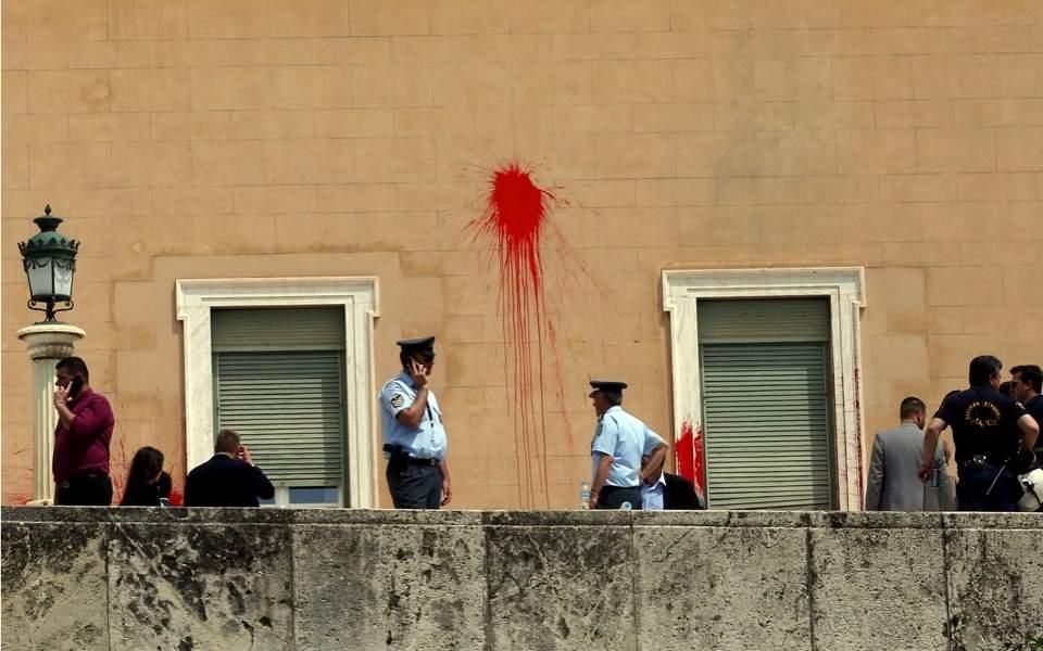 Anarchist group member arrested over Parliament vandalism