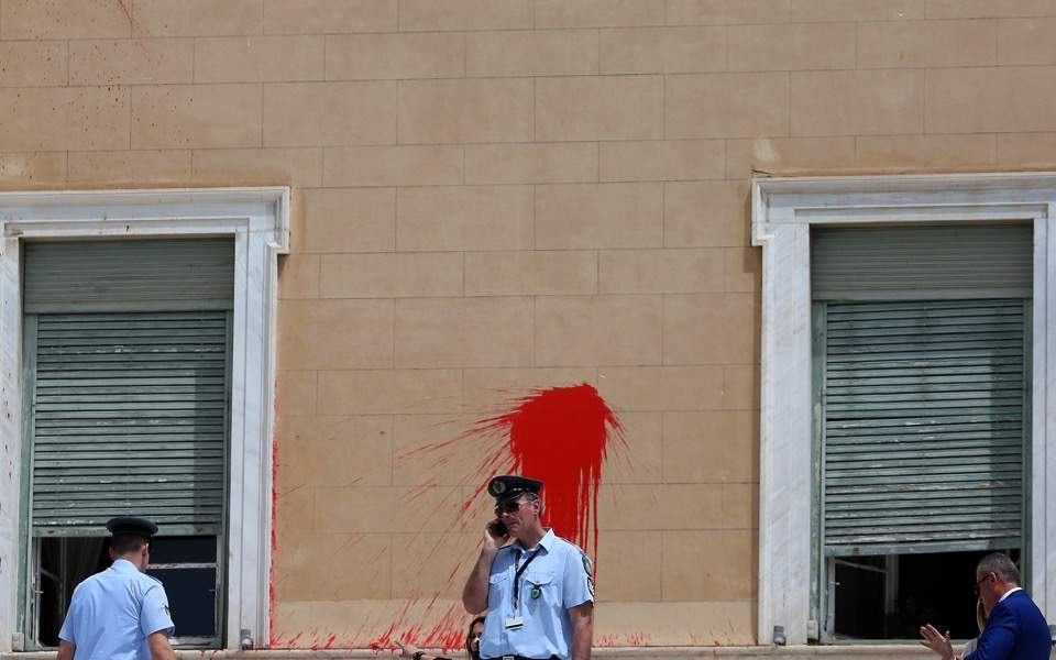 Anarchists deface Parliament after lapse in security