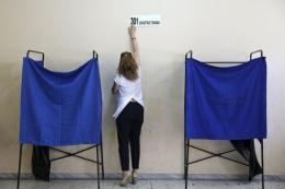 a-referendum-official-puts-up-a-sticker-reading-301-polling-station-at-an-athens-high-school-that-will-be-used-as-a-polling-station-for-sundays-referendum-in-greece_1436006734546914_v0_l-1-1