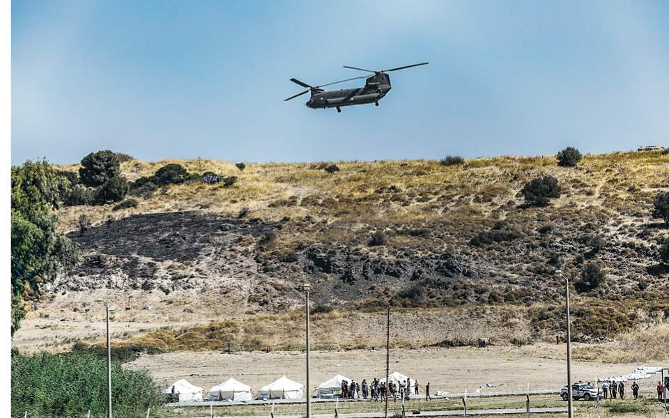moria-helicopter-migrants-tents