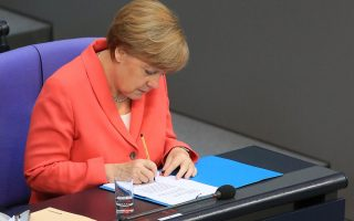 merkel-may-face-more-defections-in-greece-vote-ally-fuchs-says