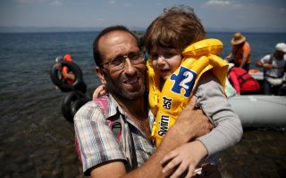 refugees-cheer-pray-embrace-strangers-as-they-reach-greece0