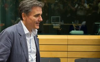 greece-to-receive-23-bln-in-two-tranches-after-eurogroup-sources-say