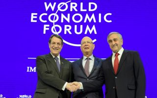 with-symbolic-handshake-at-davos-cyprus-leaders-ask-elite-to-back-peace