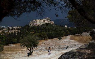 tourists-walk-on-pnyx-hill