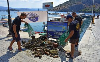 divers-survey-trash-removed-from-the-seabed-off-tolo