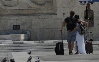tourists-enjoy-a-quieter-emptier-athens-despite-the-heat