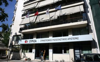 carnival-mask-attackers-throw-petrol-bombs-at-syriza-offices