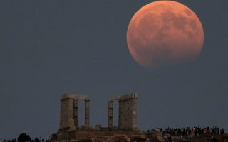 august-full-moon-with-partial-eclipse-over-the-temple-of-poseidon