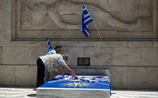 protesters-lay-flags-during-rally-against-athens-skopje-name-deal