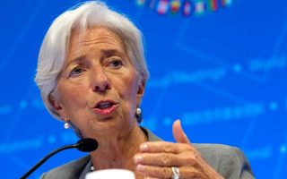 imf-chief-lauds-review-completion-concerned-about-long-term-debt