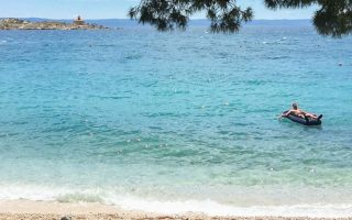 greek-lifeguards-rescue-tourist-swept-out-to-sea-with-inflatable-lounger