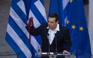 tsipras-marks-agreement-on-greek-debt-with-red-tie0