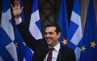 greek-pm-dons-tie-in-sartorial-relief-over-bailout-end