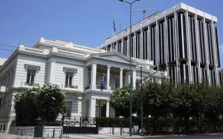 rouvikonas-members-throw-paint-at-greek-foreign-ministry