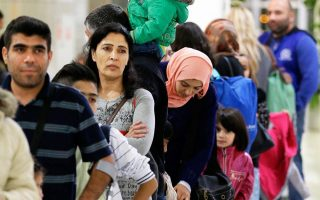 first-117-refugees-leave-greece-to-be-reunited-with-families-in-germany