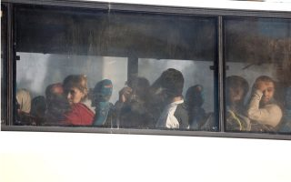 migrants-and-refugees-transferred-to-camps-after-squat-raids