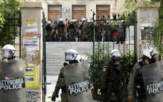 police-clash-with-youths-outside-athens-business-school